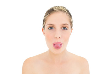 Charming fresh blonde woman posing with tongue out