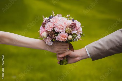wedding bouquet in the newlywed's hands