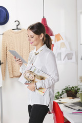 Fashion woman blogger working in a creative workspace with digit