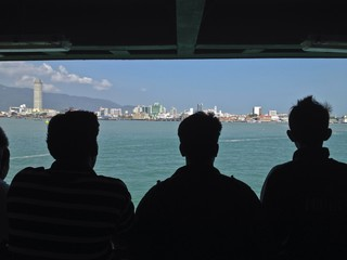Travelers on Ferry Boat Crossing Georgetown Penang Malaysia