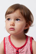happy thinking 2-year-old baby looking towards her future