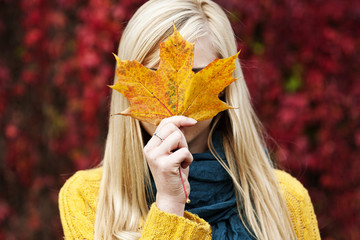 Beautiful blond young woman - autumn portrait