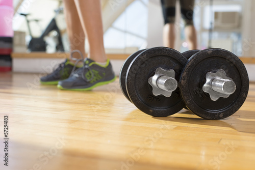 Dumbbells with the girl in background