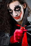 Funny joker with sharp knife