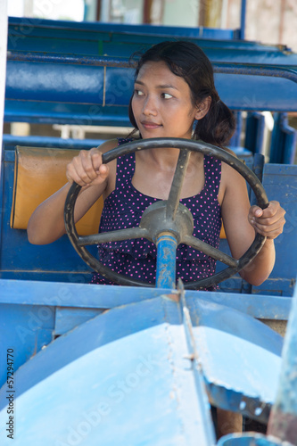 Asian woman driving old bus
