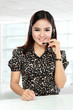 Businesswoman in office place communicate by wireless headset