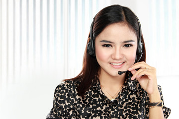 Friendly help desk woman smiling call center operator phone