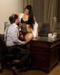 sexy manager and woman at the office flirting