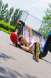 Teenage rollerblader taking a fall