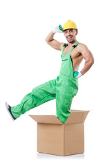 Man in coveralls with boxes