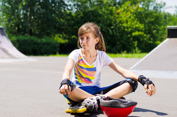 Young girl relaxing with her skating gear