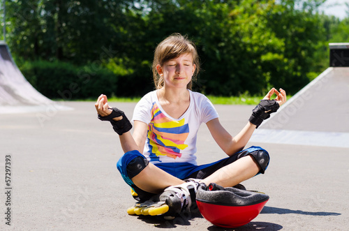 Pretty young teenager sitting meditating