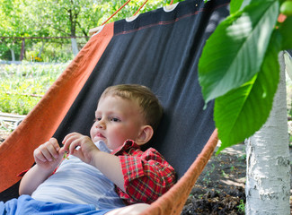 Cute little boy relaxing in a hammock
