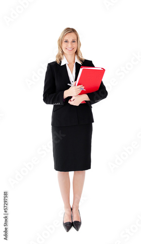 Attractive businesswoman with a pen and a folder against white b