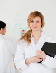 Woman posing in front of a whiteboard