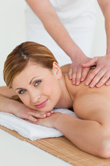 Attractive blond-haired woman getting a massage