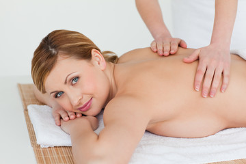 Lovely blond-haired woman getting a massage