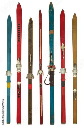 Leinwanddruck Bild Vintage colorful used skis isolated on white