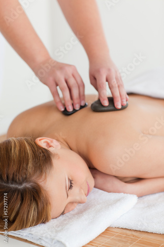 Therapist making a massage to an attractive blond-haired woman