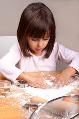 Little girl cooking cookies