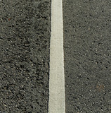 White line on the road.