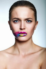 young model with bright makeup creative colorful bright lips