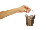 Woman hand with a steel pail