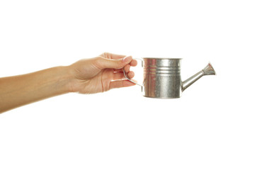Woman hand with a steel watering can