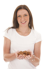 Young woman holding typical Dutch candy pepernoten isolated