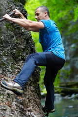 Man climbing mountain wall