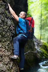 Man climbing mountain wall