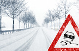 Fototapety Snowy road with traffic sign