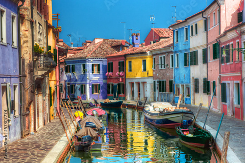 Colorful houses and canal on Burano island, near Venice, Italy.