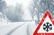 canvas print picture - Snowy curvy road with traffic sign
