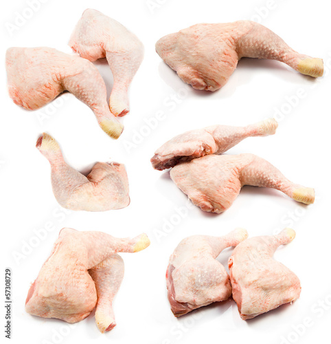 raw chicken legs on a white background