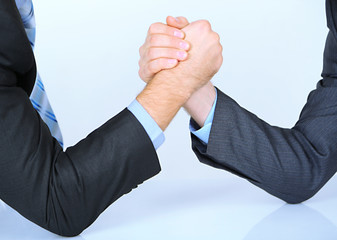 Arm wrestling: business concept isolated on white