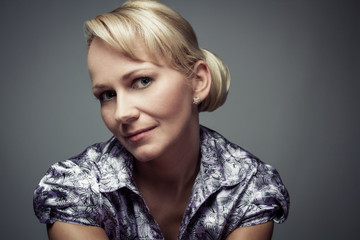 Close up Portrait of Beautiful Middle Age Blond Woman Copy Space
