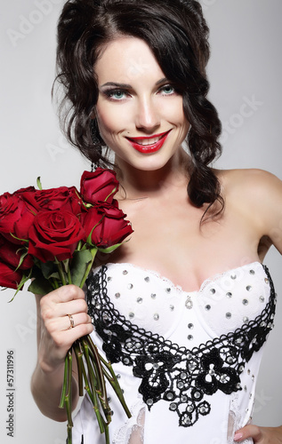 Fragrance. Woman Holding Bouquet of Red Roses. Valentine's Day