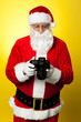 Santa checking pictures on his DSLR camera