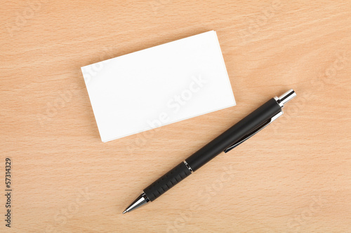 Blank business cards and pen