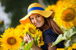 beautiful young woman on a field of sunflowers