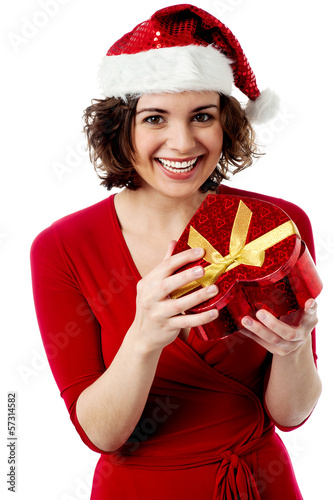 Excited female santa opening gift box