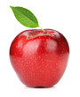 Ripe red apple with green leaf