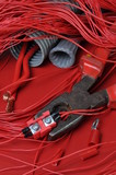 Electrical components and tools in the current colors of red-hot poster