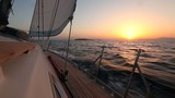 Yacht sailing against sunset. Luxury yacht. (HD)