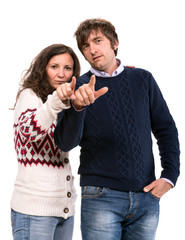 Man and woman pointing at camera
