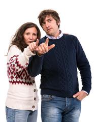 Man and woman pointing at camera