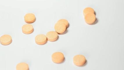 Orange pills falling