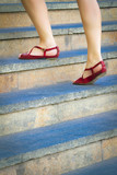 Woman stepping up a stairway. Lifestyle or social concept.