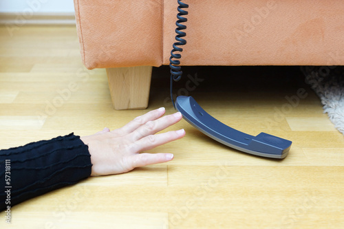 woman  try to reach the phone